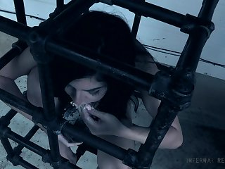 Innocent brunette teen babe Keira Croft locked up in a cage