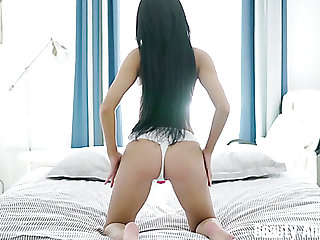 Stunning brunette white chick on the bed undresses and masturbates with a vibrator